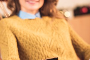 selective focus of woman shopping on