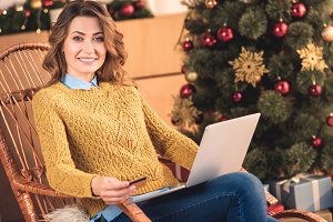 smiling woman shopping online with c