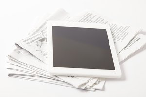 close up of pile of newspapers with