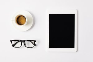 flat lay with cup of coffee, eyeglas