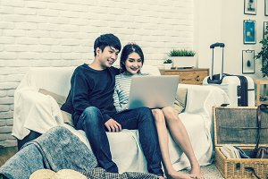Happy Asian Couple planning and book