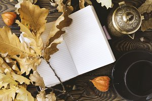 Diary, cup of hot coffee, autumn oak