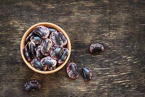 dark beans on a dark wooden backgrou