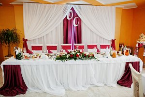 Wedding table decorated with red ros