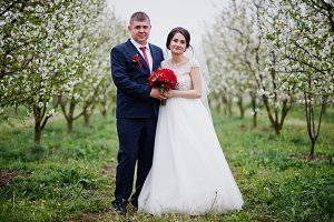 Gorgeous newly married couple posing