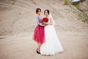 Bride posing with her bridesmaid in