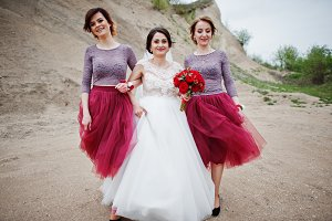 Bride posing with her bridesmaids in