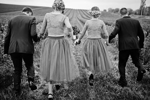 Groomsmen and bridesmaids running in