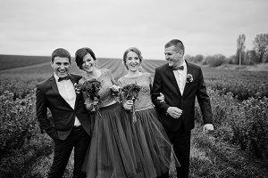 Groomsmen and bridesmaids having fun