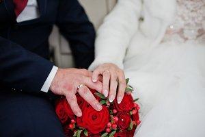 Close-up photo of wedding couple hol