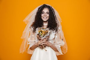 Cheerful dead bride in wedding dress