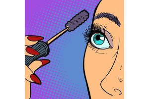 Woman paints eyelashes, makeup