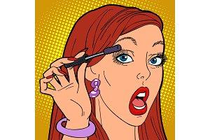 Woman paints eyelashes, make-up
