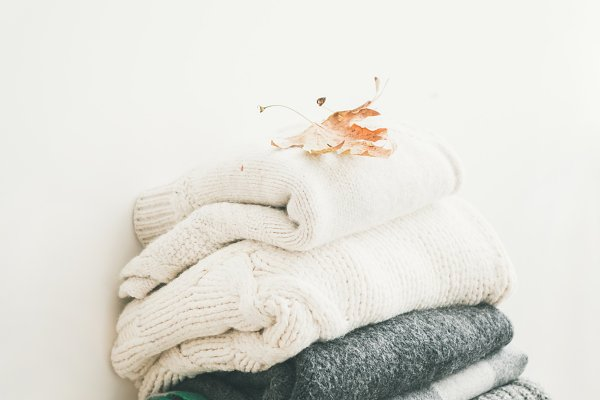 Abstract Stock Photos - Pile of warm winter sweaters and