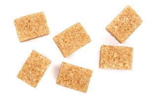 brown sugar cubes isolated on white