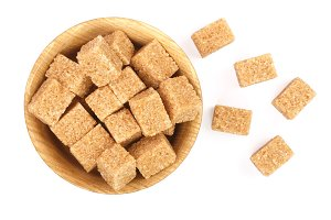 brown sugar cubes in a wooden bowl