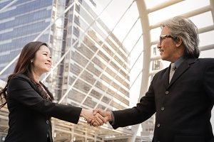 Senior business people shaking hands