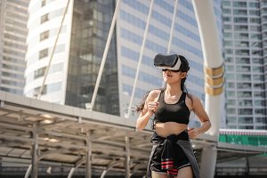 Asian fitness woman with VR glasses
