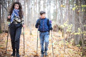 Nordic walking. Little boy and young
