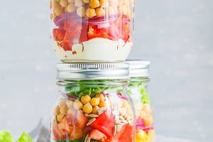 Glass jars with layering vegan salad