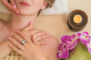 Caucasian blond girl having a massag