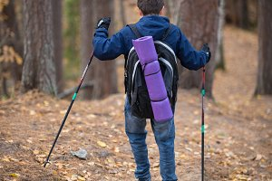 Little boy with hikers backpack