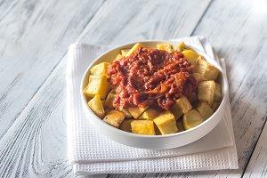 Portion of patatas bravas with sauce