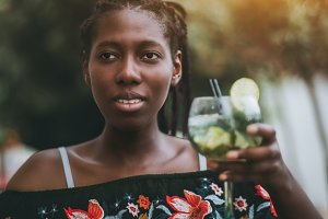 African girl with glass of coctail
