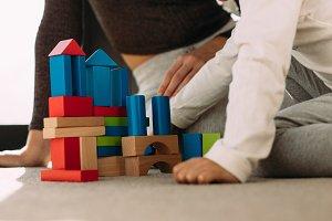 Child playing colorful blocks game