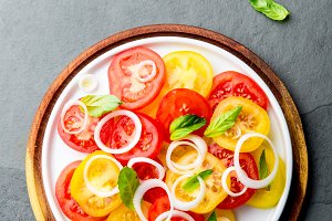 Red and yellow fresh tomato salad