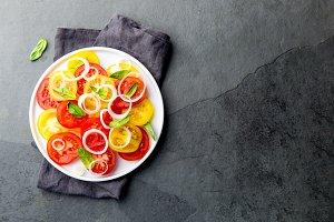 Red and yellow fresh tomato salad