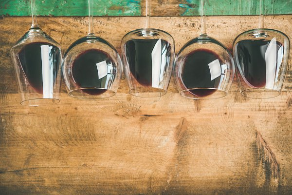 Red wine in glasses over rustic