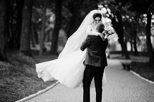 Romantic newly married couple dancin