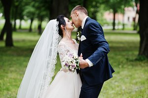 Fantastic young wedding couple kissi