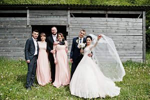 Bridesmaids with groomsmen and weddi