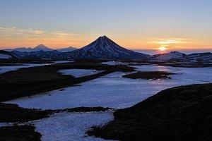 Landscape of sunrise over volcano