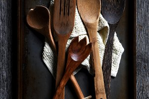 Wooden cooking utensils on a baking