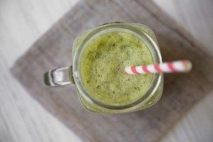 Glass jar of green celery smoothie