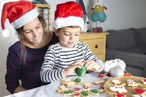 Mother and son decorating biscuits