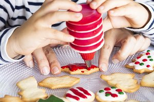 Little kid decorating biscuits
