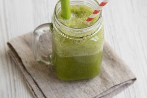 Glass jar of green celery smoothie