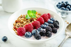 Bowl of homemade granola with yogurt