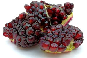 Pomegranate red grains on white
