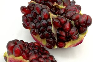 Pomegranate grains on white