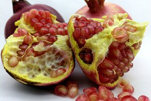 Open pomegranate and red grains