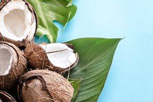 Coconut with tropical leaves