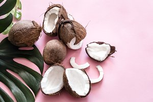 coconut halves and tropical leaves