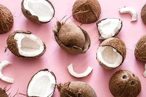 Coconut halves on pink background