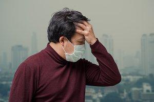Asian man wearing the face mask agai