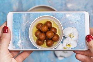 Mobile shot of gulab jamun